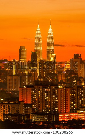 Sunset skyline of Kuala Lumpur city with Petronas Twin Towers or Kuala Lumpur City Centre (KLCC) as part of the skyline. - stock photo