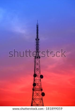 Sunset stands radio towers  - stock photo