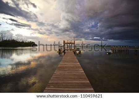 Sunset Storm on the Dock - stock photo