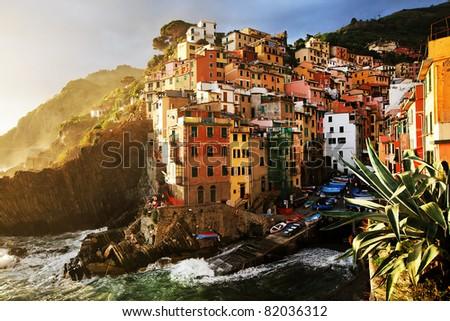 Sunset stormy light in Riomaggiore Village, Cinque Terre, Italy - stock photo