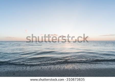 Sunset, sunbeam, sea. Okinawa, Japan. - stock photo
