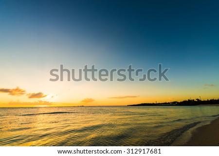 Sunset, sunlight, sea. Okinawa, Japan, Asia. - stock photo