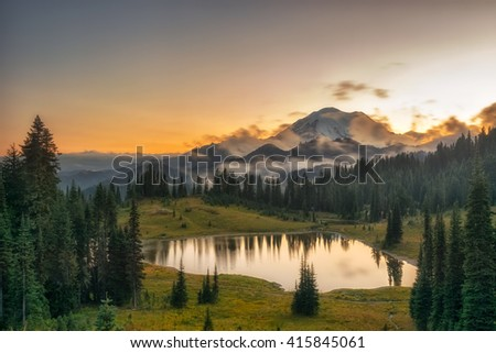 Sunset/sunrise, a famous mountain in America, tree, forest, and lake, Mt. Rainier National Park, USA - stock photo