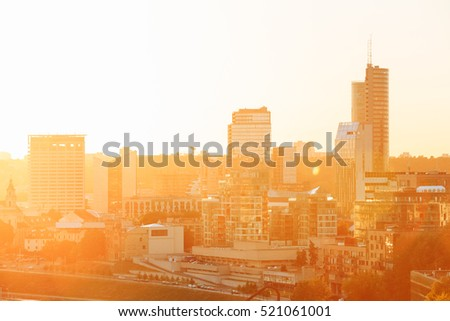 Sunset Sunrise Cityscape Of Vilnius, Lithuania In Summer. Beautiful View Of Modern Center In Evening. Sunshine Sky