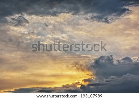 Sunset / sunrise in the sky with storm clouds - stock photo