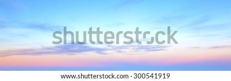 Sunset / Sunrise light with orange, red, yellow, blue and white sky. - stock photo