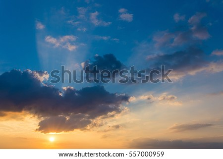 Sunset / sunrise with clouds, light ray and other atmospheric effect