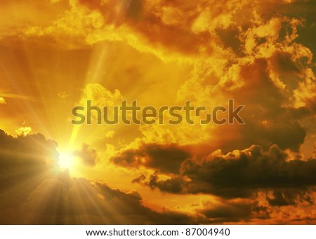 Sunset / sunrise with clouds, light rays and other atmospheric effect