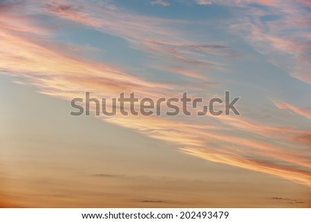Sunset / sunrise with clouds on blue sky - stock photo