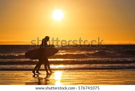 sunset surfers - stock photo