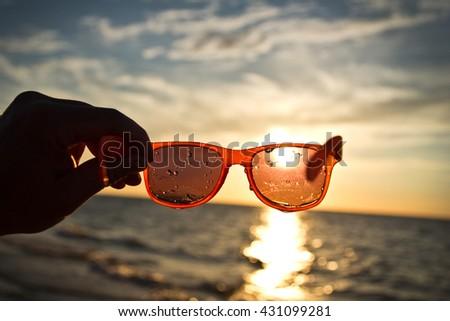 sunset through sunglasses - stock photo