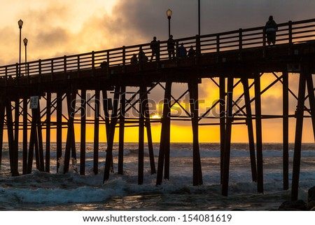Sunset Through the Oceanside Pier in San Diego - stock photo
