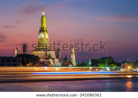 Sunset time view of Wat Arun (Temple) across Chao Phraya River in Bangkok, Thailand. - stock photo