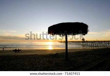 Sunset Umbrella Silhouette - stock photo