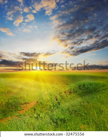 Sunset under rural landscape