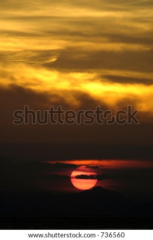 sunset under yellow clouds - stock photo