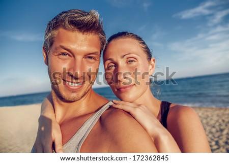 sunset vacation couple on beach - stock photo