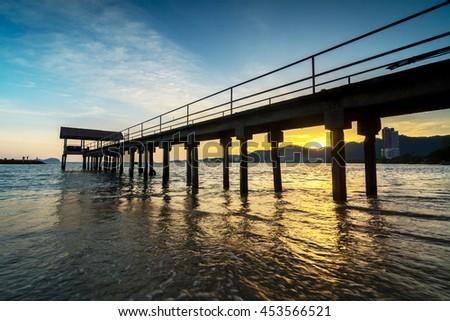 Sunset view at fisherman jetty Sungai Batu, Penang Malaysia. Nature composition - stock photo