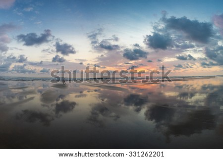 Sunset view at the beach of Matapalo with silhouette of people having a walk, Costa Rica. Matapalo is located in the Southern Pacific Coast. Costa Rica 2013. - stock photo