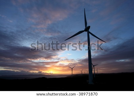 Sunset view at wind farm.