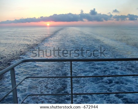 sunset view from a boat - stock photo