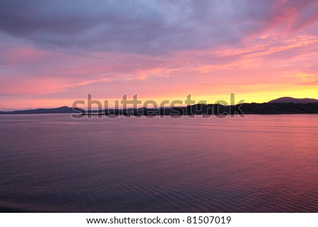 sunset view from a boat off the coast of norway - stock photo