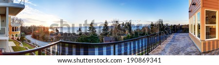 Sunset view from a walkout deck. Panoramic picture - stock photo