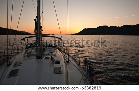 sunset view from nose of yacht - stock photo