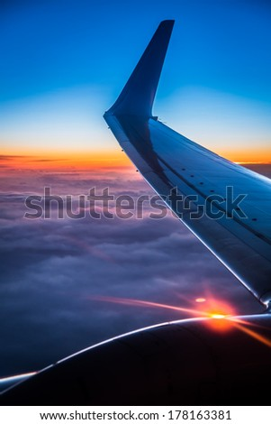 Sunset view from the airplane window - stock photo