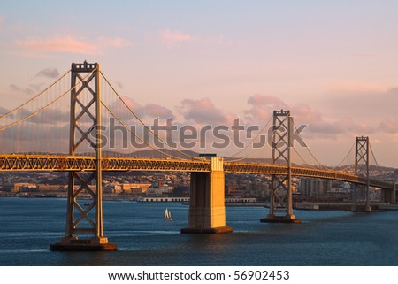 Sunset View of Bay Bridge between Treasure Island and San Francisco, California. - stock photo