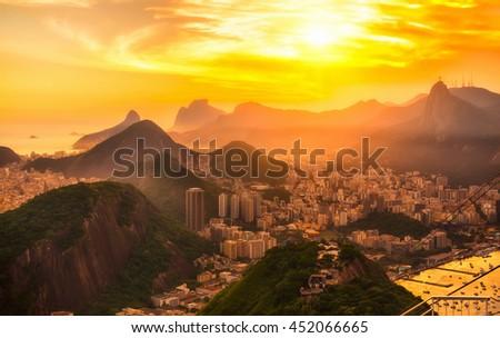Sunset view of Botafogo, mountain Corcovado and Christ the Redeemer  in Rio de Janeiro. Brazil - stock photo