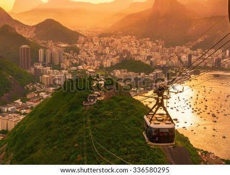 Sunset view of Botafogo, mountain Urca and cable car to mountain Sugar Loaf in Rio de Janeiro. Brazil - stock photo