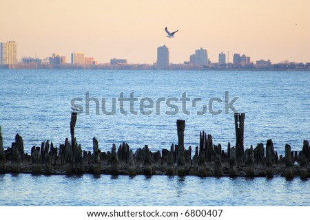 Sunset view of city Chicago from the water - stock photo
