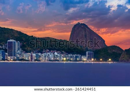 Sunset view of Copacabana and mountain Sugar Loaf in Rio de Janeiro. Brazil - stock photo