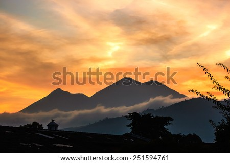 Sunset view of Fuego & Acatenango volcanoes near Antigua, Guatemala, Central America - stock photo