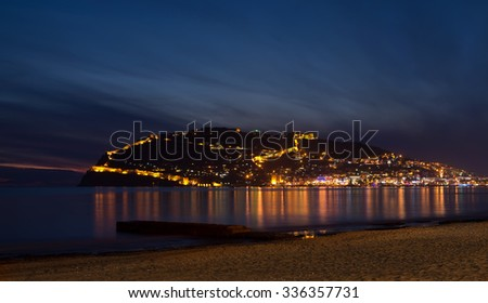 Sunset view of harbor, sea and fortress in Alanya, Turkey
