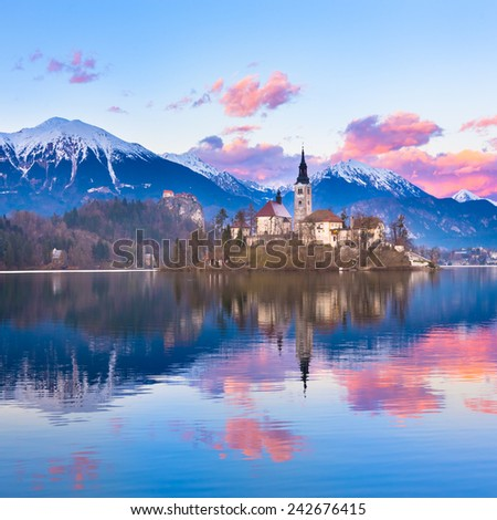 Sunset view of Julian Alps, Lake Bled with St. Marys Church of the Assumption on the small island. Bled, Slovenia, Europe. - stock photo