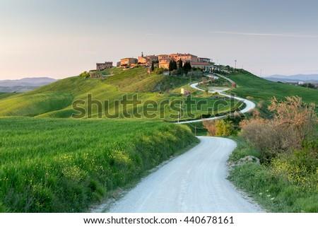 Sunset view of Mucigliani village, Tuscany, Italy - stock photo