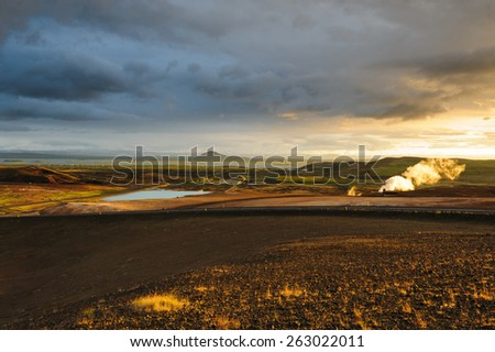 Sunset view of Myvatn lake with small electro station on the foreground on a cloudy evening, North Iceland - stock photo