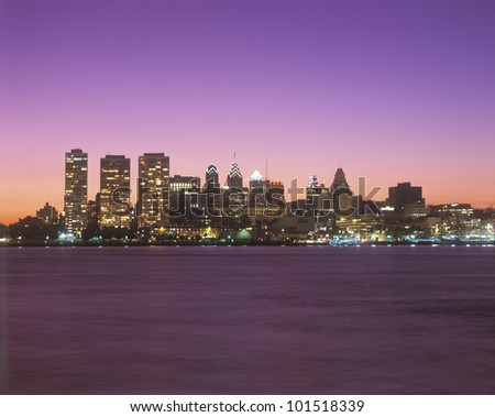 Sunset view of skyline of Philadelphia, Pennsylvania from the Delaware River - stock photo
