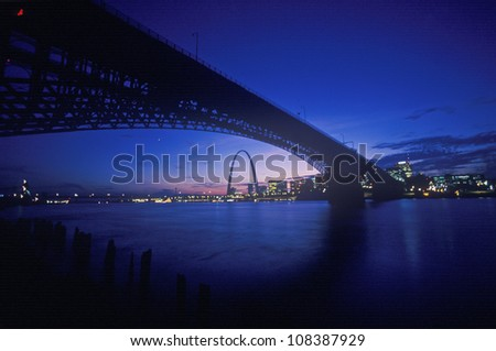 Sunset view of St. Louis, Missouri skyline and Eads Bridge - stock photo