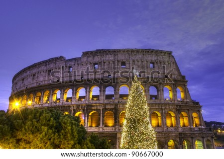 Sunset View of the Colosseum and of its Christmas tree, Rome, Italy