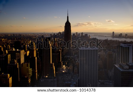Sunset view of the Empire State Building from the Rockefeller building in new York - stock photo