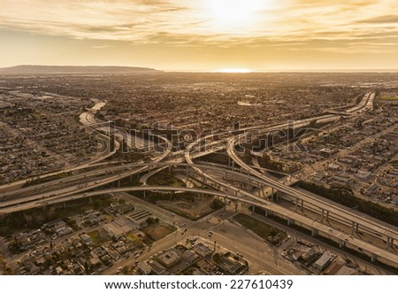Sunset view of the freeway system in Los Angeles. - stock photo