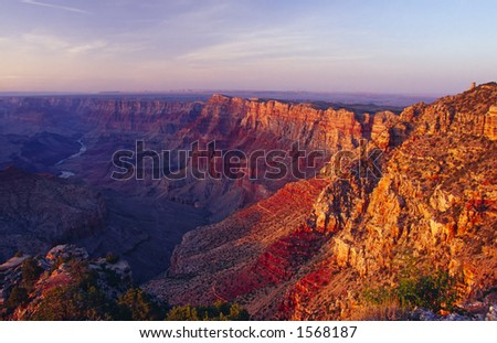 Sunset View of the Grand Canyon with the Indian Watchtower at Desert View (1932), Stands at the Eastern End of the South Rim of the Grand Canyon - stock photo