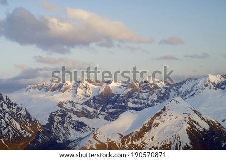 sunset view of the northern slopes of Tendenera Mountains in the Valley of Tena, Pyrenees, Huesca, Aragon, Spain - stock photo