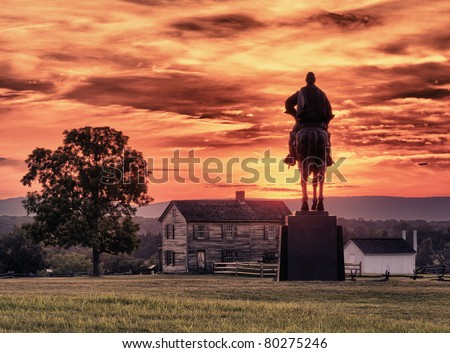 Sunset view of the statue of Andrew Jackson at Manassas Civil War battlefield where the Bull Run battle was fought.  Henry House is in the middleground. The statue was acquired for the nation in 1940 - stock photo