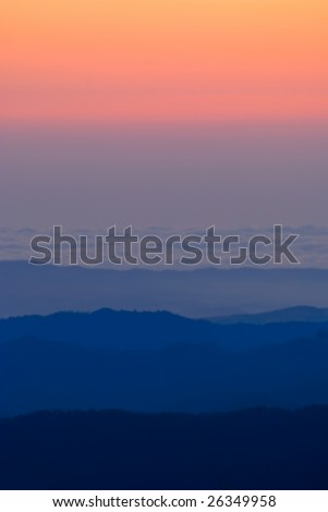 Sunset View of the Troodos mountains from peak Olympus, Cyprus. - stock photo