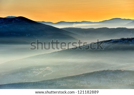 Sunset view of the winter mountains