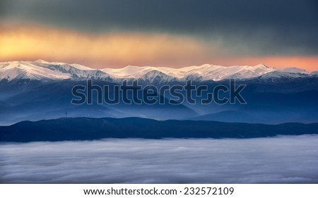 Sunset view of the winter mountains - stock photo